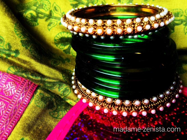Green glass bangles with pearl - gold side bangles. Photography.